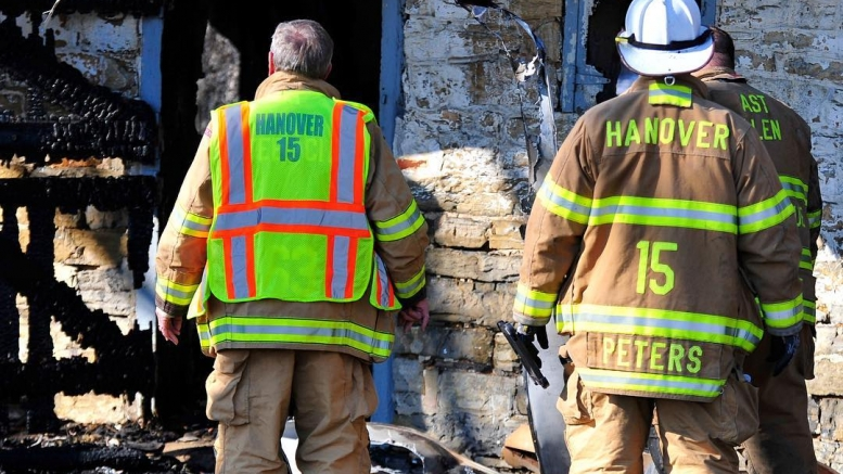 Hanover Township fire investigators assess the scene of a barn fire that started just after midnight Sunday Feb. 7th. 2016 in Hanover Township, Northampton County, Pa.