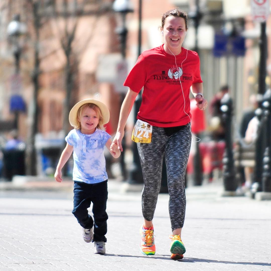 Young Lilly joins her mom Stacey on the final leg of the Brew to Brew 10K run