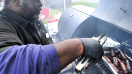Jay King dishes up smoked sausages at the Nazareth Jazz Fest