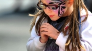 Ava Wozniak checks out crafts for sale at the Nazareth Jazz Fest