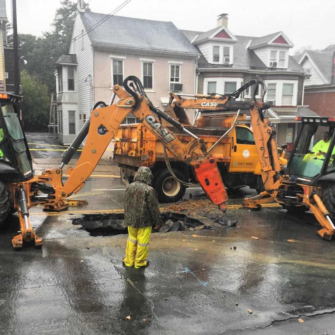 ON SCENE: Crews work on fixing a massive sinkhole where homes were condemned following yesterday's gas leak and water main break in Bethlehem, Pa.