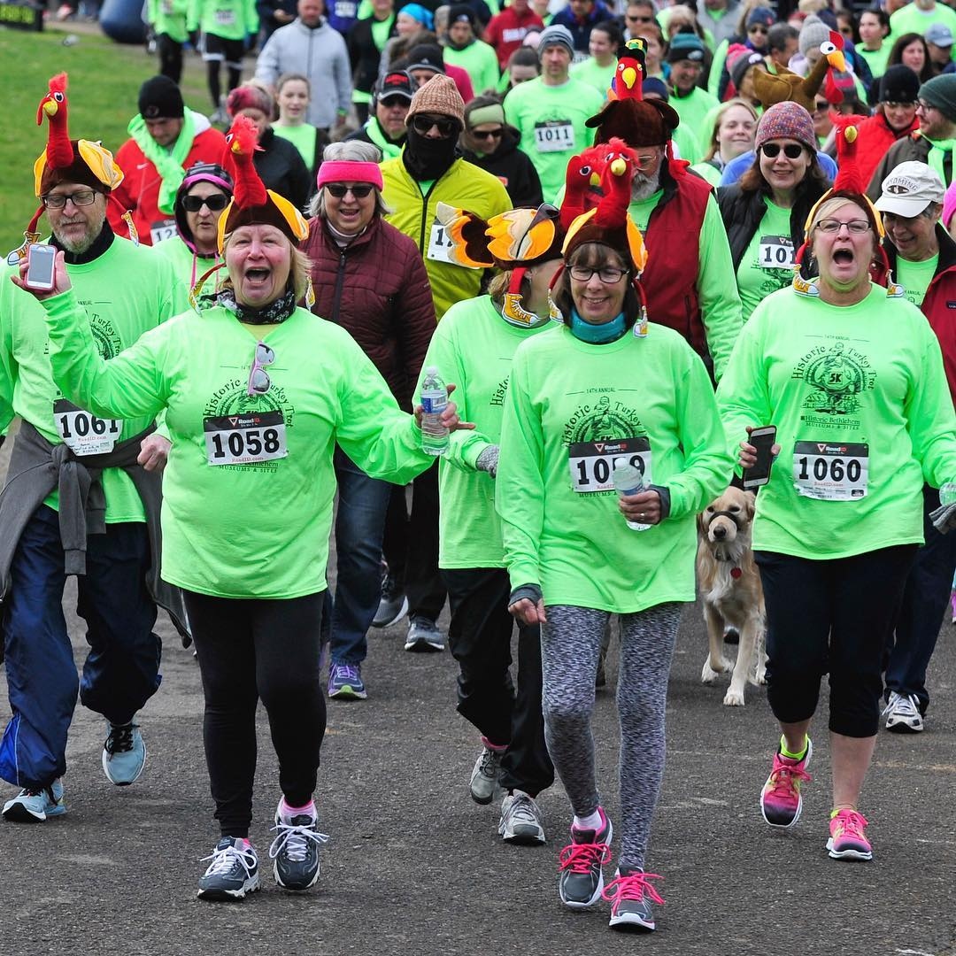 Runners and walkers, some dressed in seasonal themed costumes participate in the Historic Turkey Trot 5K Run and Fitness Walk on Nov. 19, 2016, at the Colonial Industrial Quarter in Bethlehem.