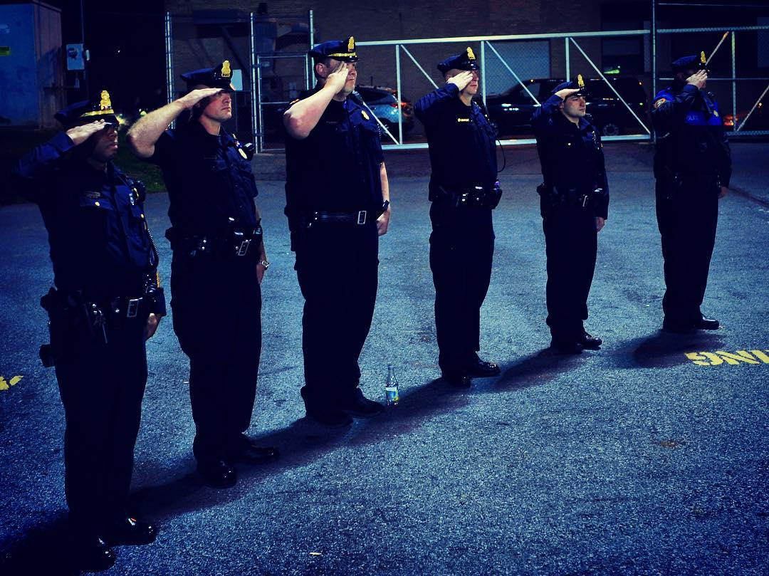 Bethlehem Police Officers salute during the playing of the national anthem.