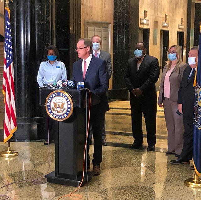 Senator Pat Toomey and Philadelphia civic leaders speaks to media